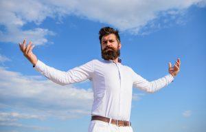 bearded man in white shirt looking arrogant