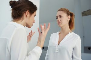 two female workers arguing