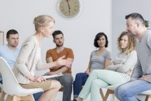 group of colleagues in meeting man and woman arguing