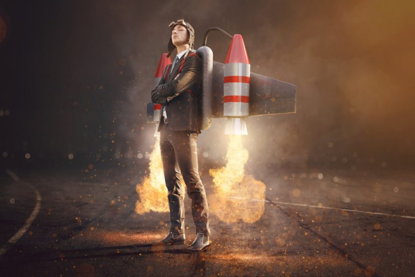 man with jetpack attached